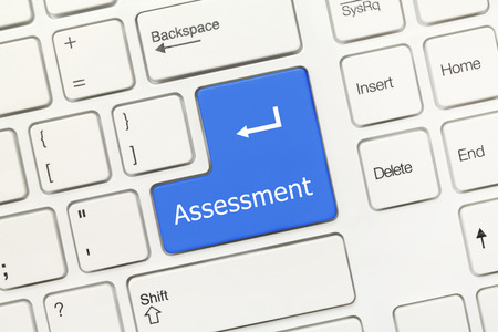 analisys: Close-up view on white conceptual keyboard - Assessment (blue key) Stock Photo