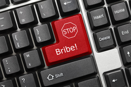 control fraud: Close-up view on conceptual keyboard - Bribe (red key) Stock Photo