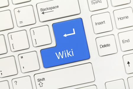 wiki: Close-up view on white conceptual keyboard - Wiki (blue key)