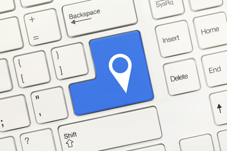 geolocation: Close-up view on white conceptual keyboard - Blue key with geolocation symbol