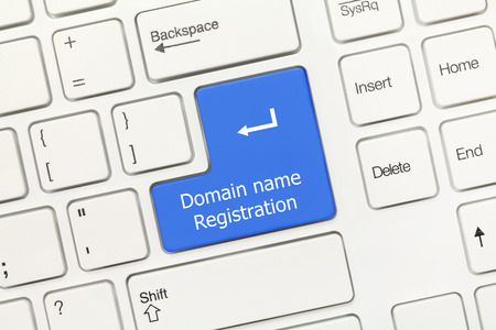 webhost: Close-up view on white conceptual keyboard - Domain name registration (blue key)
