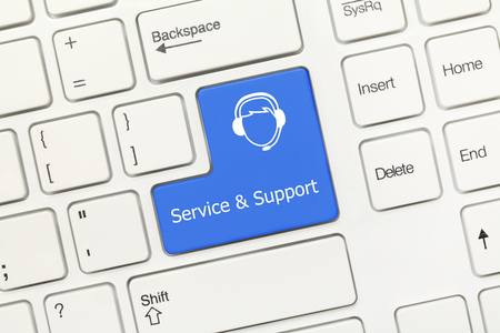 Close-up view on white conceptual keyboard - Service and Support (blue key with call-center operator)