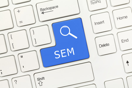 sem: Close-up view on white conceptual keyboard - SEM (blue key with magnifying glass symbol)