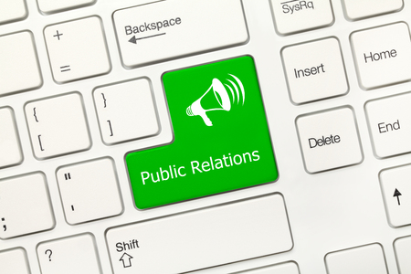 public relations: Close-up view on white conceptual keyboard - Public Relations (green key with megaphone symbol) Stock Photo