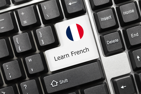 computer instruction: Close-up view on conceptual keyboard - Learn French (key with national flag)