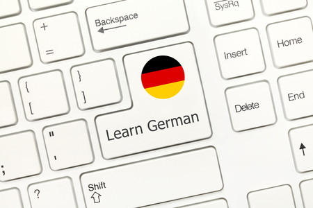 computer instruction: Close-up view on white conceptual keyboard - Learn German (key with national flag) Stock Photo