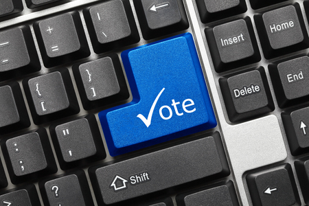 electronic voting: Close-up view on conceptual keyboard - Vote (blue key with check symbol) Stock Photo