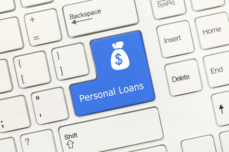 loans: Close-up view on white conceptual keyboard - Personal Loans (blue key)