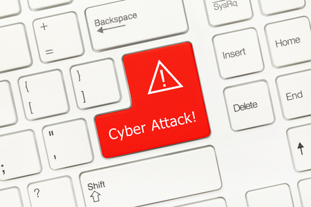 attacker: Close-up view on white conceptual keyboard - Cyber Attack (red key) Stock Photo