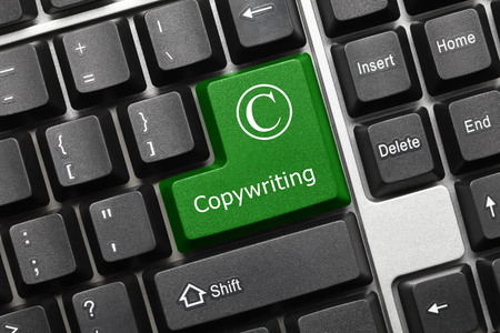 authorship: Close-up view on conceptual keyboard - Copyrighting (green key)