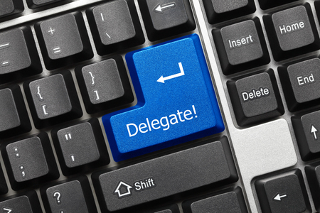 delegate: Close-up view on conceptual keyboard - Delegate (blue key) Stock Photo