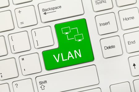 Close-up view on white conceptual keyboard - VLAN (green key)