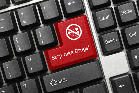 Close-up view on conceptual keyboard - Stop take drugs (red key) Stock Photo