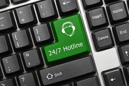 Close-up view on conceptual keyboard - 24/7 Hotline (green key with operator symbol)