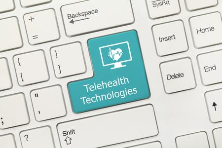 Close-up view on white conceptual keyboard - Telehealth Technologies (blue key) 免版税图像