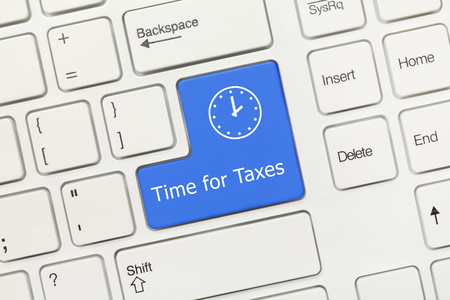 Close-up view on white conceptual keyboard - Time for Taxes (blue key) Stock Photo