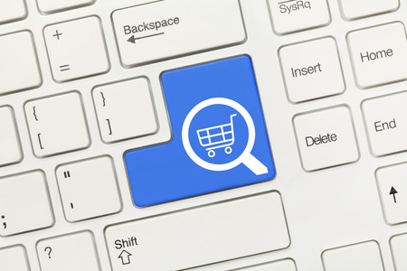 Close-up view on white conceptual keyboard - Search (blue key with loupe and shopping cart symbols)