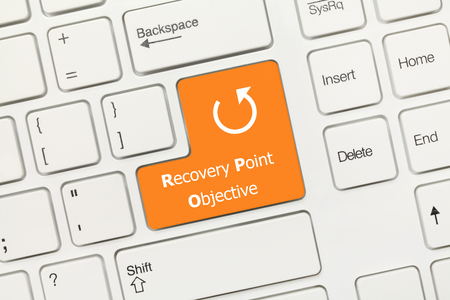 Close-up view on white conceptual keyboard - Recovery Point Objective (orange key)