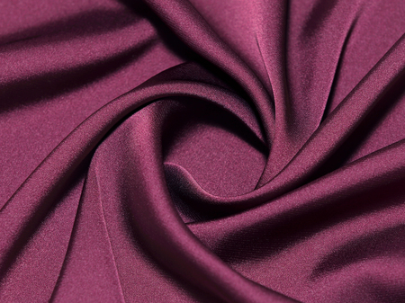 Close-up view on twisted maroon silk