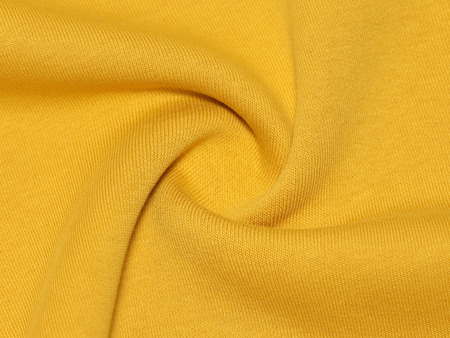 Close-up view on twisted yellow cloth Stok Fotoğraf