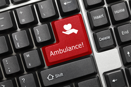 Close-up view on conceptual keyboard - Ambulance (red key with healthcare symbol)