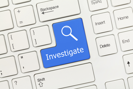 Close-up view on white conceptual keyboard - Investigate (blue key)