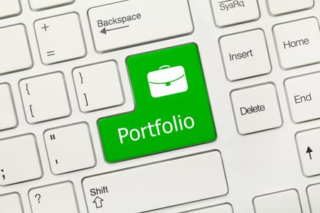 Close-up view on white conceptual keyboard - Portfolio (green key)