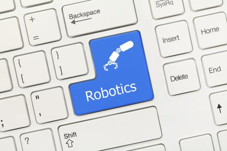 Close-up view on white conceptual keyboard - Robotics (blue key)