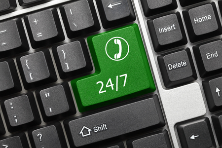 Close-up view on conceptual keyboard - 24/7 (green key with phone symbol)