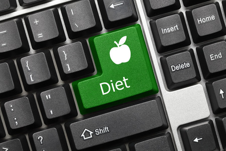 Close-up view on conceptual keyboard - Diet (green key with apple symbol)