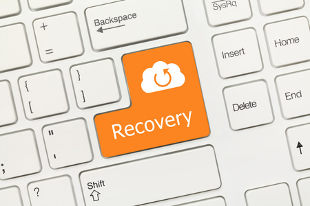 Close-up view on white conceptual keyboard - Recovery (orange key with Cloud symbol) Archivio Fotografico