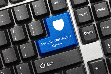 Close-up view on conceptual keyboard - Security Operations Center (blue key)