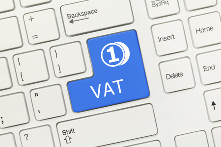 Close-up view on white conceptual keyboard - VAT (blue key) Stock Photo