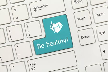 Close-up view on white conceptual keyboard - Be healthy (blue key) 版權商用圖片