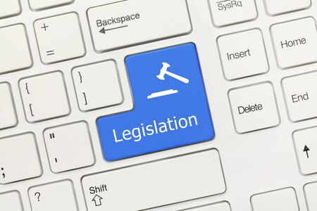 Close-up view on white conceptual keyboard - Legislation (blue key with gavel symbol)