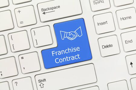 Close-up view on white conceptual keyboard - Franchise Contract (blue key)