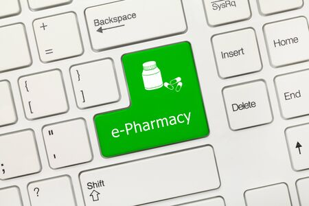 Close-up view on white conceptual keyboard - e-Pharmacy (green key)