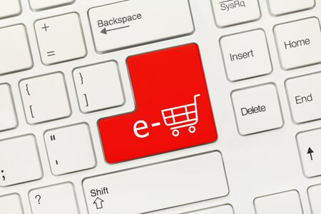 Close-up view on white conceptual keyboard - e-shop symbol (red key)