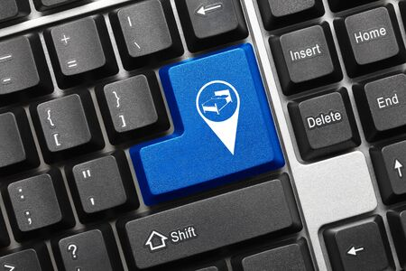 Close-up view on conceptual keyboard - Blue key with hotel geolocation symbol