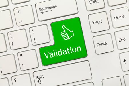Close-up view on white conceptual keyboard - Validation (green key)