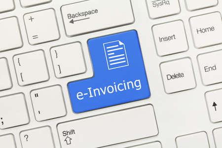 Close-up view on white conceptual keyboard - e-Invoicing (blue key)