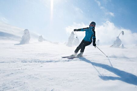Girl goes down the winter slope on alpine skiing 写真素材