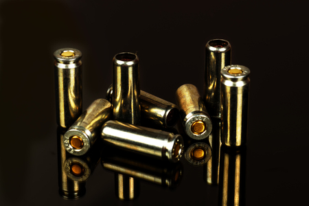gunfire: Cartridges for the traumatic gun close up on a black background. Stock Photo