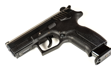 The black gun (pistol) on a white background close up. Isolate. Stock Photo