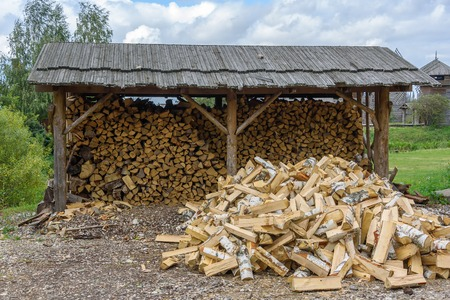 sawn: Pile of birch firewood outdoors in summer