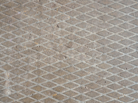Concrete slab background with a notch in the form of rhombuses.
