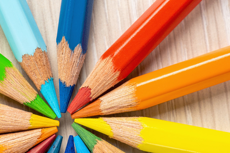 Color pencils in a circle on a white background. Drawing with colored pencils.