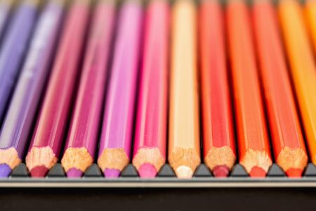 Set of colored pencils. Colored pencils for drawing different colors in box.Macro photo. Stock Photo