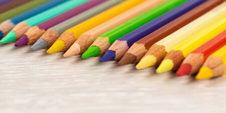 Set of colored pencils. Colored pencils for drawing different colors on a light background. Stock Photo