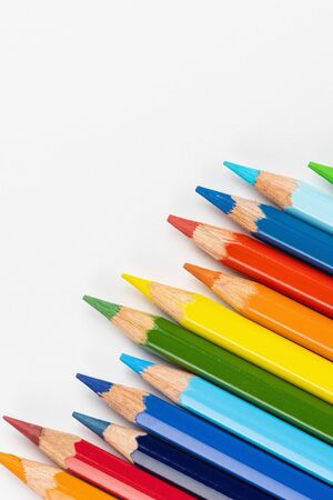 Set of colored pencils. Colors of rainbow. Colored pencils for drawing different colors on a white background.